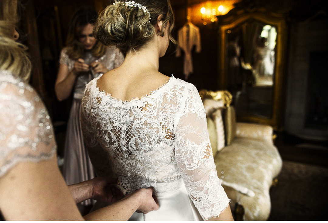 The wedding dress goes on at Hengrave Hall