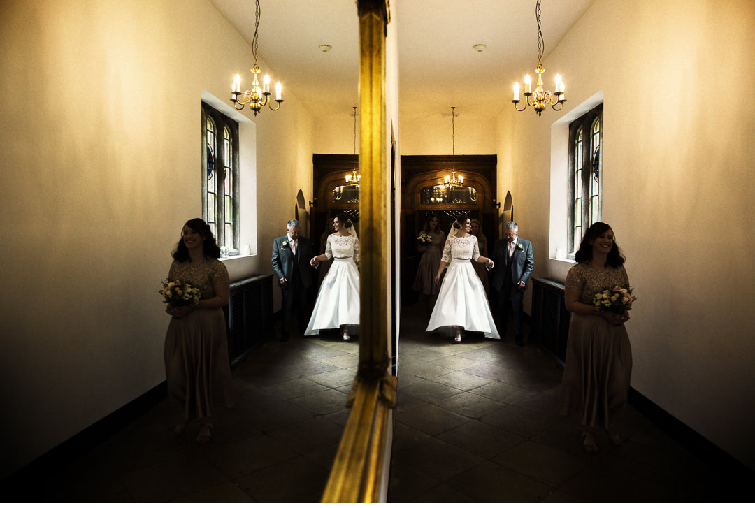 Mirror reflection of Bride and her father