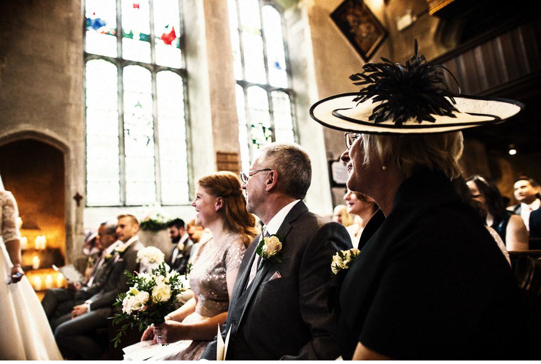 Bride's parents watch the church ceremony