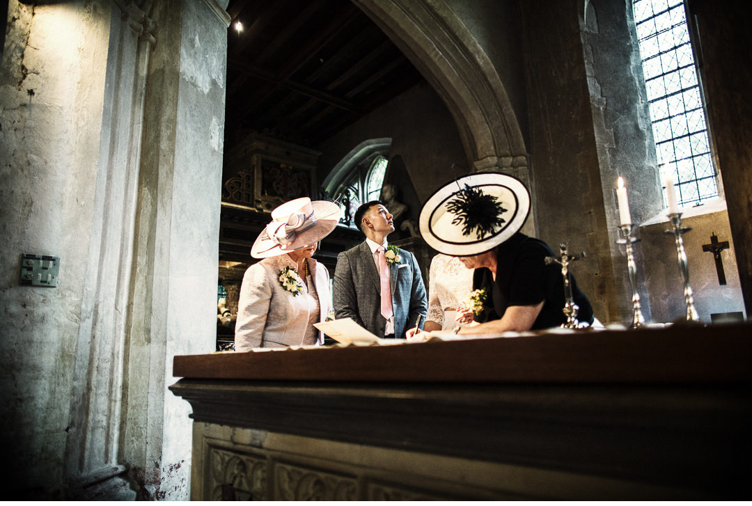 The witnesses sign the register