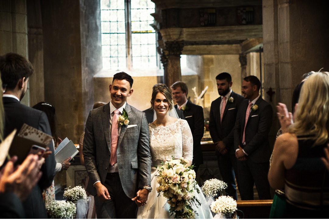 Walking down the aisle at Hengrave Hall