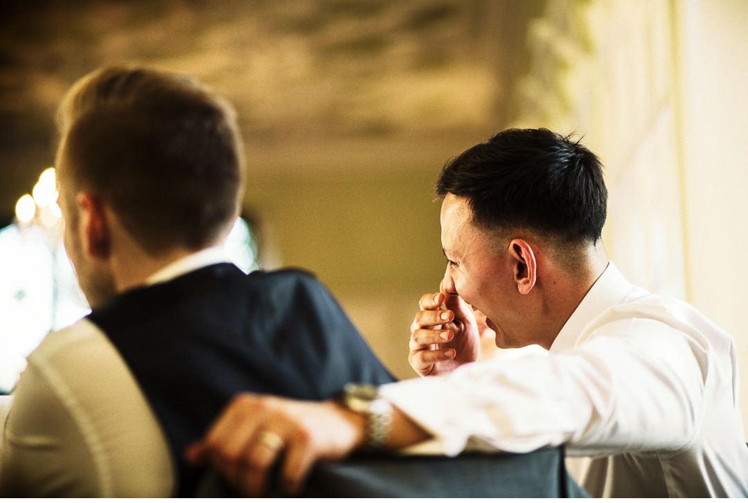 The groom has a good laugh