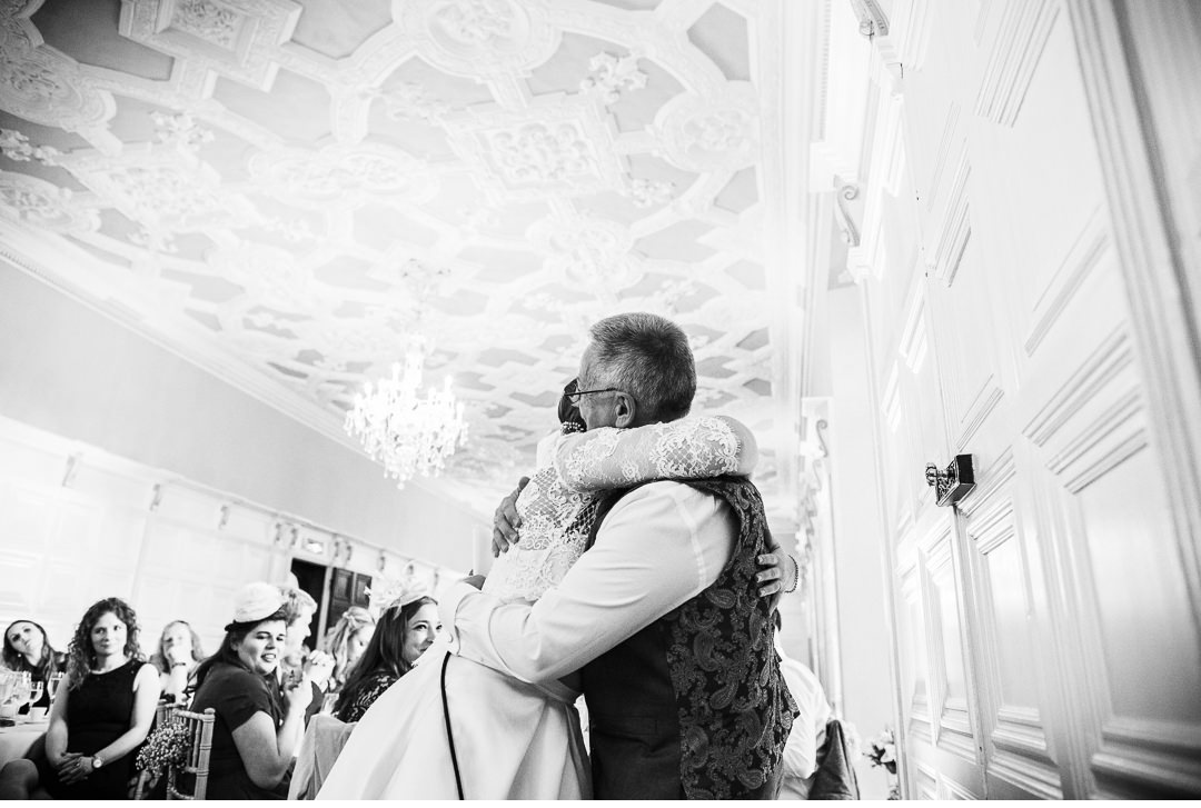 An emotional Bride and her father