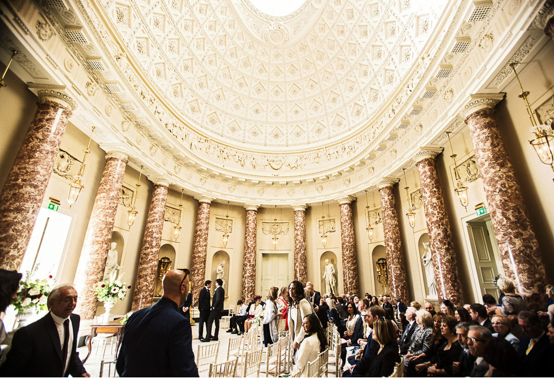 Wide angle shot of wedding guests in the Marble Saloon