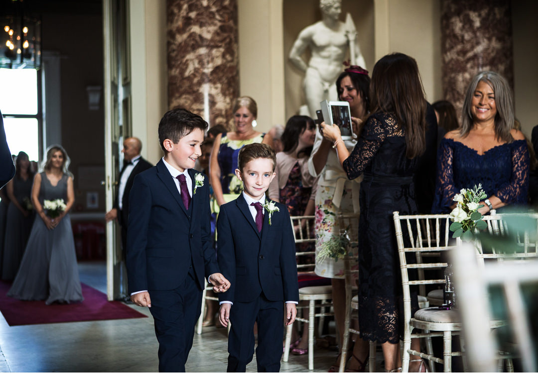 Pageboys walking up the aisle