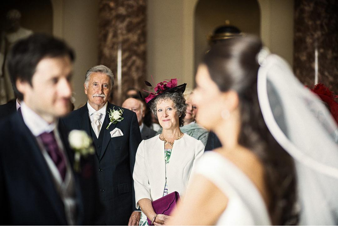 Groom's parents watching the wedding ceremony