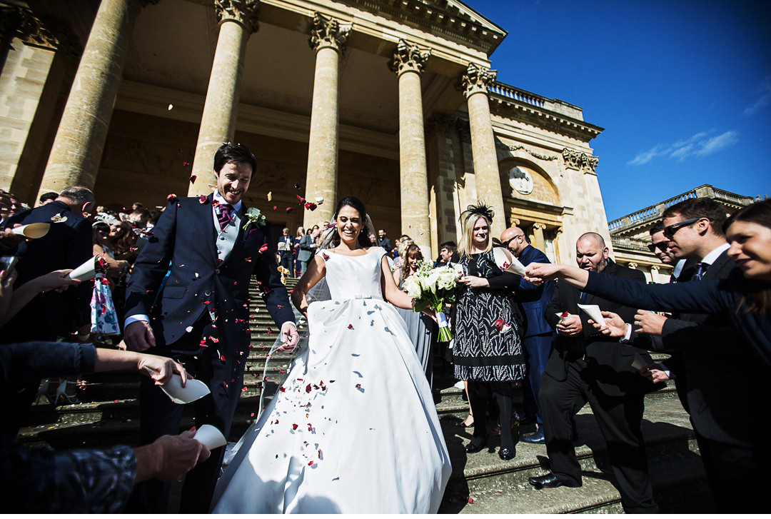 The couple enjoying the confetti at Stowe House Wedding