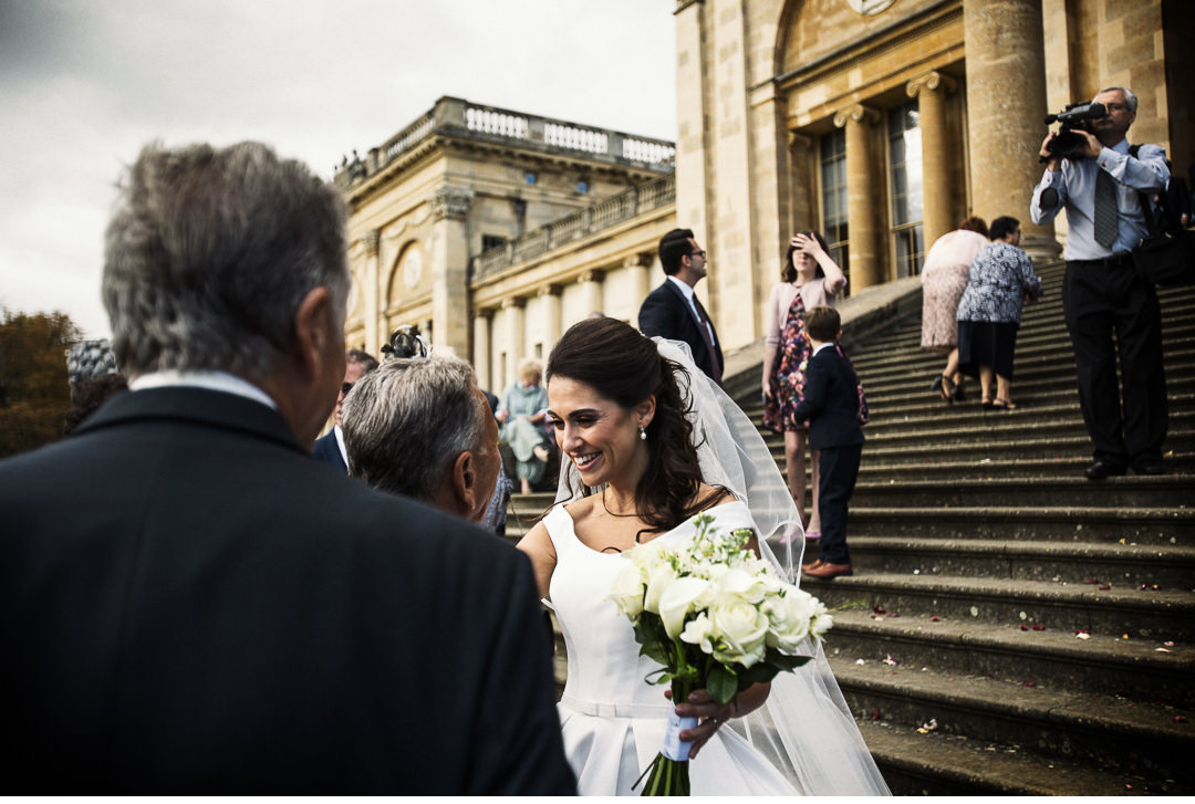 The Bride greets a wedding guest