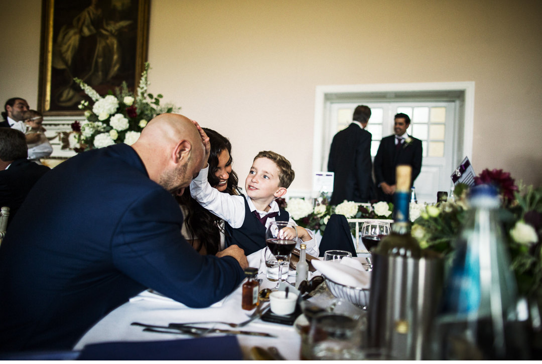 A cheeky page boy during dinner at Stowe House