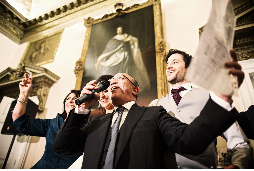 Bride and Groom join in the singing at Stowe House