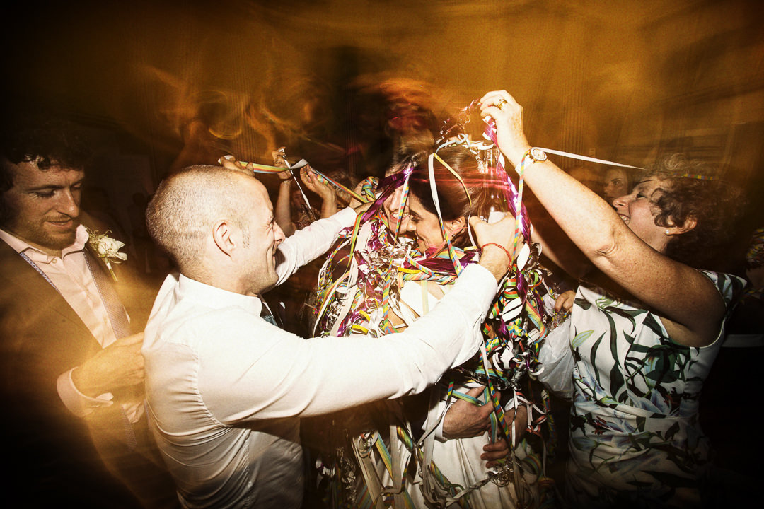 Getting absolutely covered in ribbons during their first dance