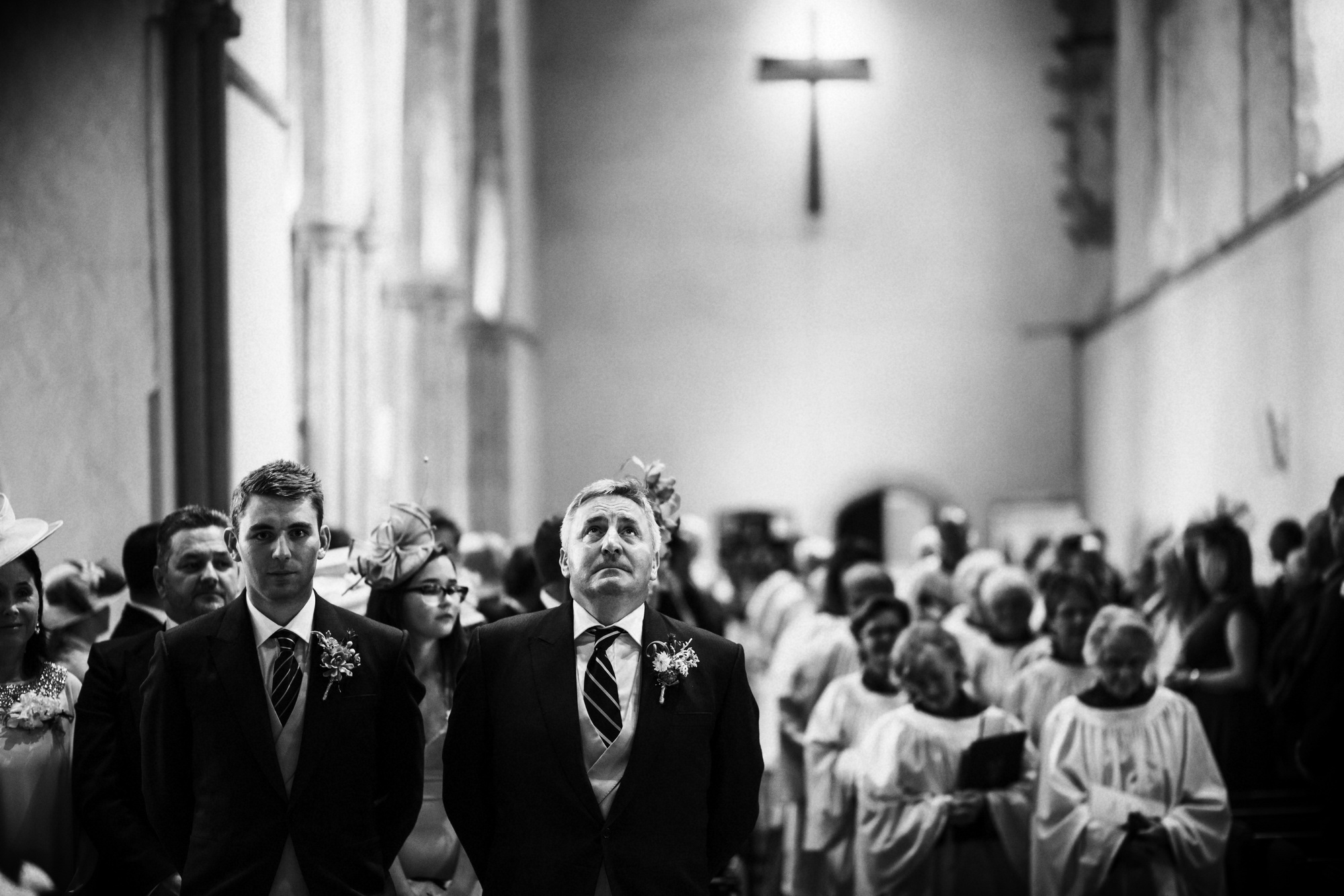 Documentary wedding photography capturing father and son