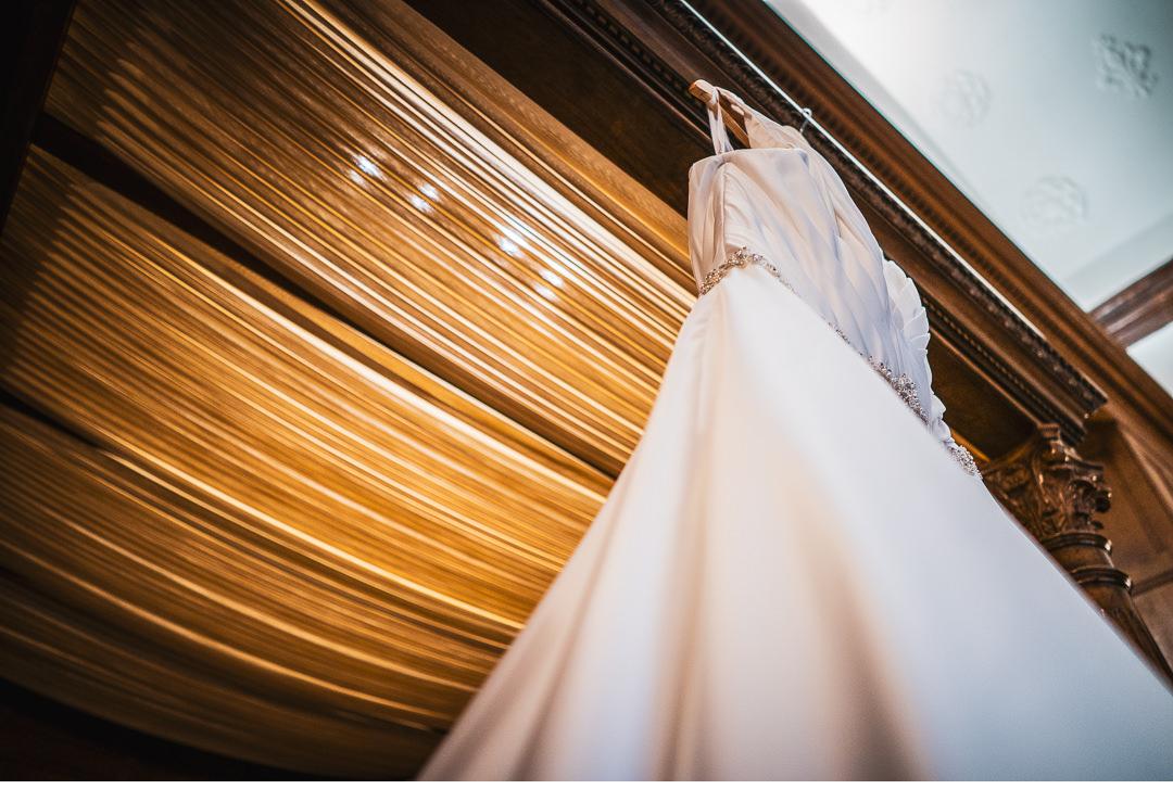 Wedding dress hanging up in Elizabethan suite