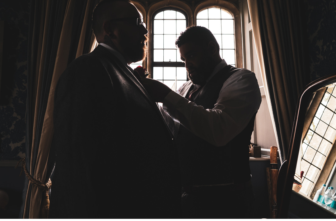 Groomsmen prep at Hengrave Hall
