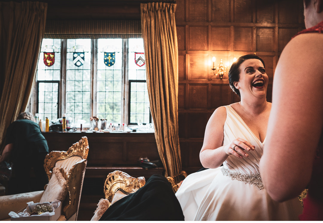 Bride having a laugh at Hengrave Hall