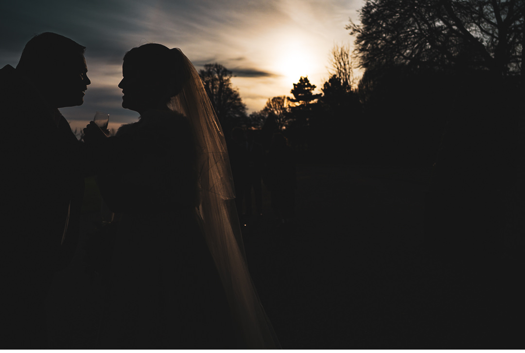 Bride silhouette against sunset