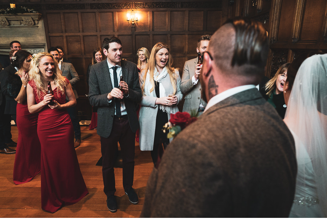 Guests congratulating couple as they arrive at reception