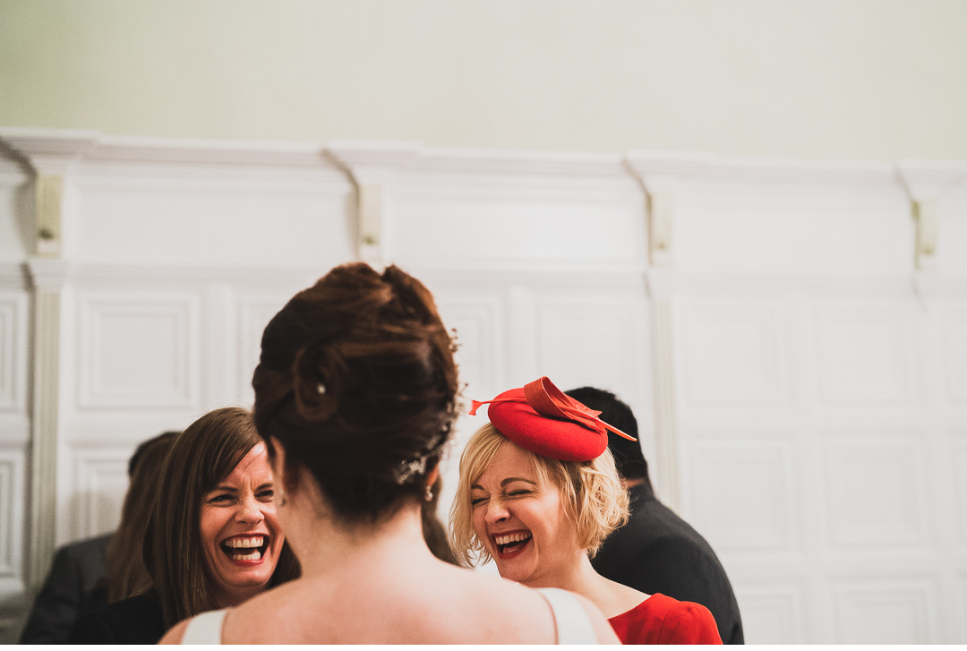 Bride chatting and laughing with friends