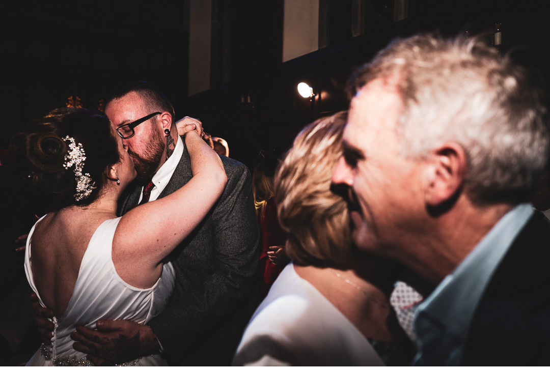 Kissing on the dance floor at Hengrave Hall