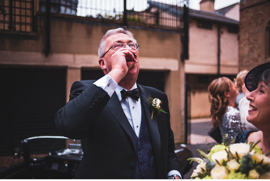 A nip of whiskey before the ceremony