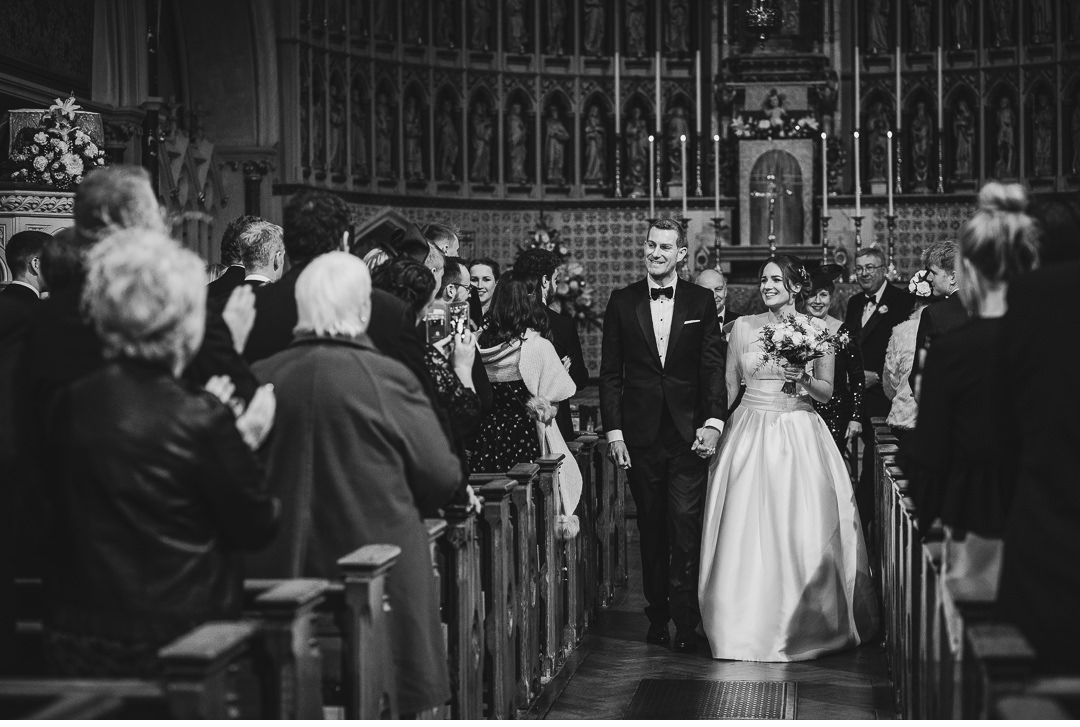 Man and wife walking up the aisle
