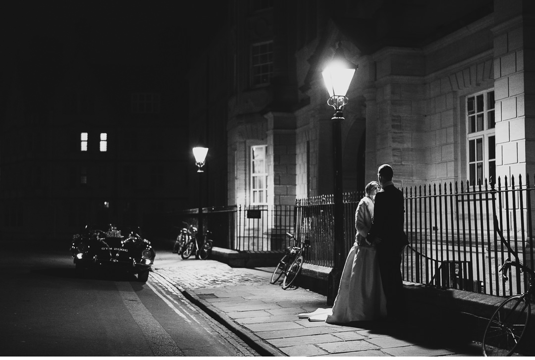 Wedding couple under street light in Oxford