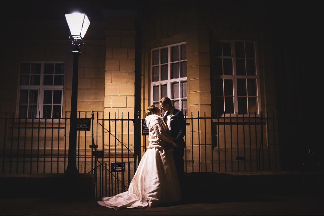 Married couple under street lamp in Oxford