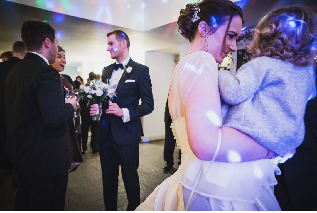 Bride, Groom, and their daughter at wedding reception