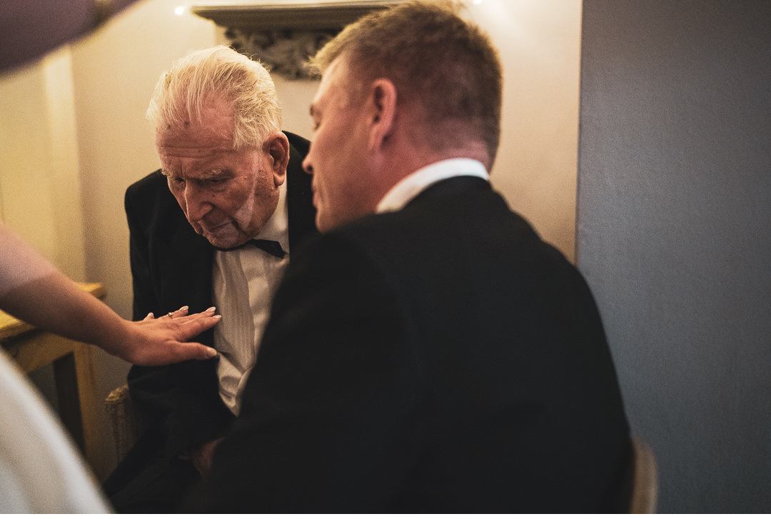 Grandfather looking at the wedding ring