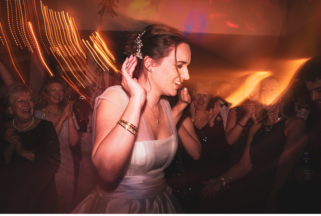 Bride getting on the dance floor