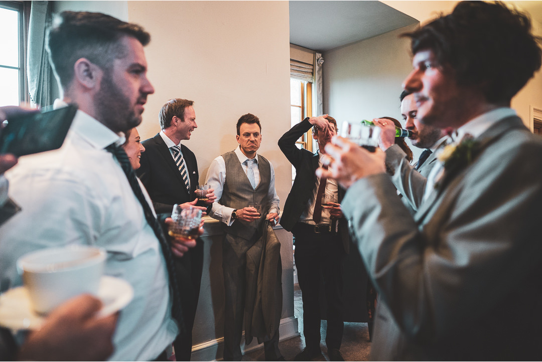 Friends having a drink together at a wedding reception