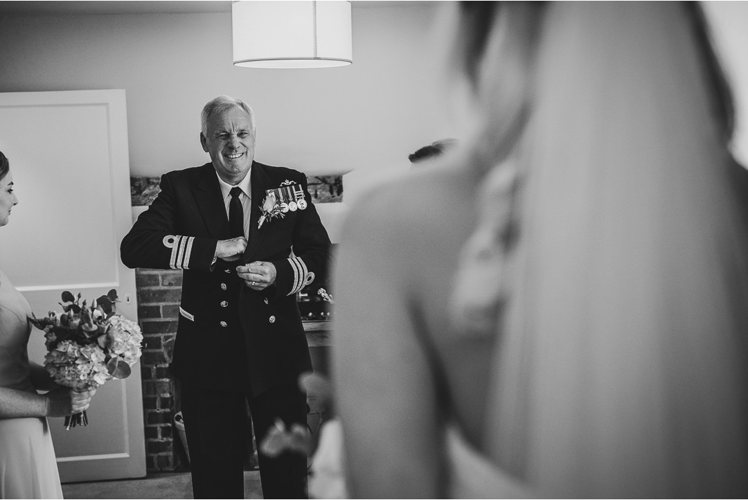 Father of the Bride seeing his daughter for the first time in her dress