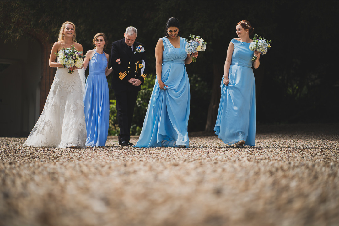 The Bridal party walking across to the ceremony at Farnham Castle