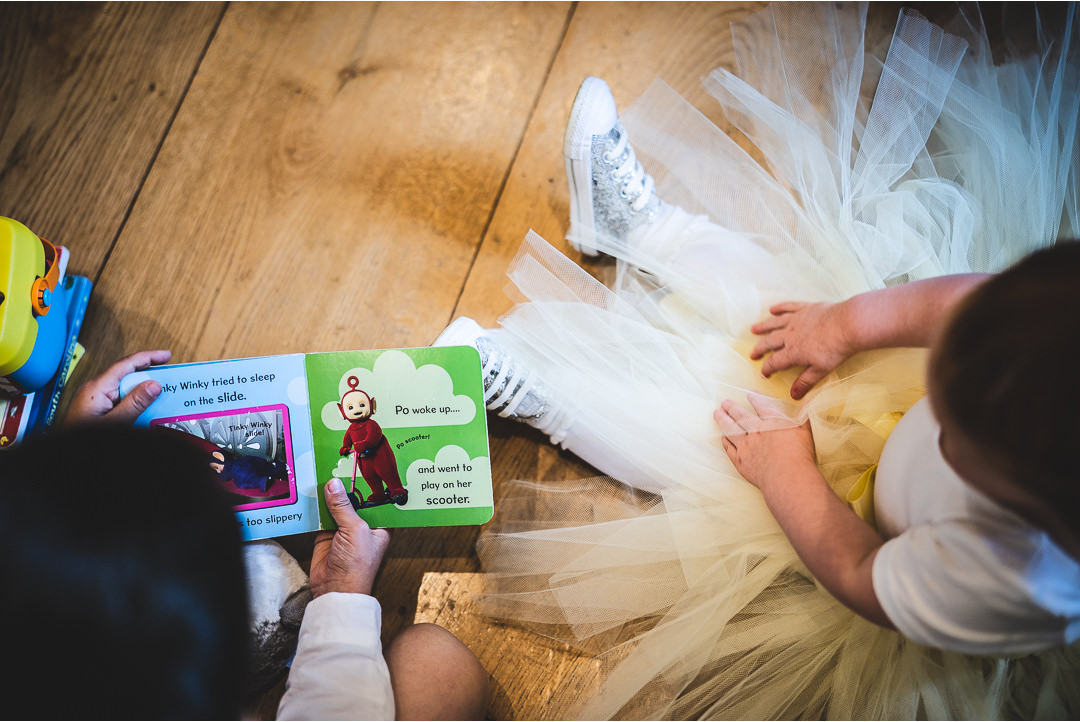 Kids reading together before the wedding