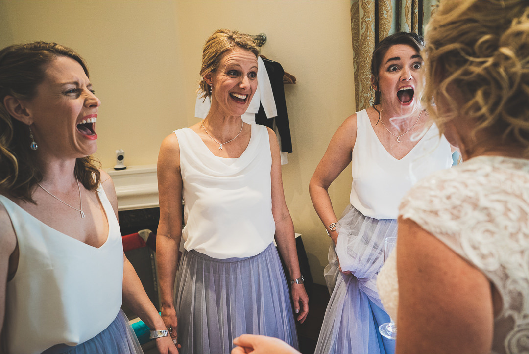 Bridesmaids' reactions to the dress going on