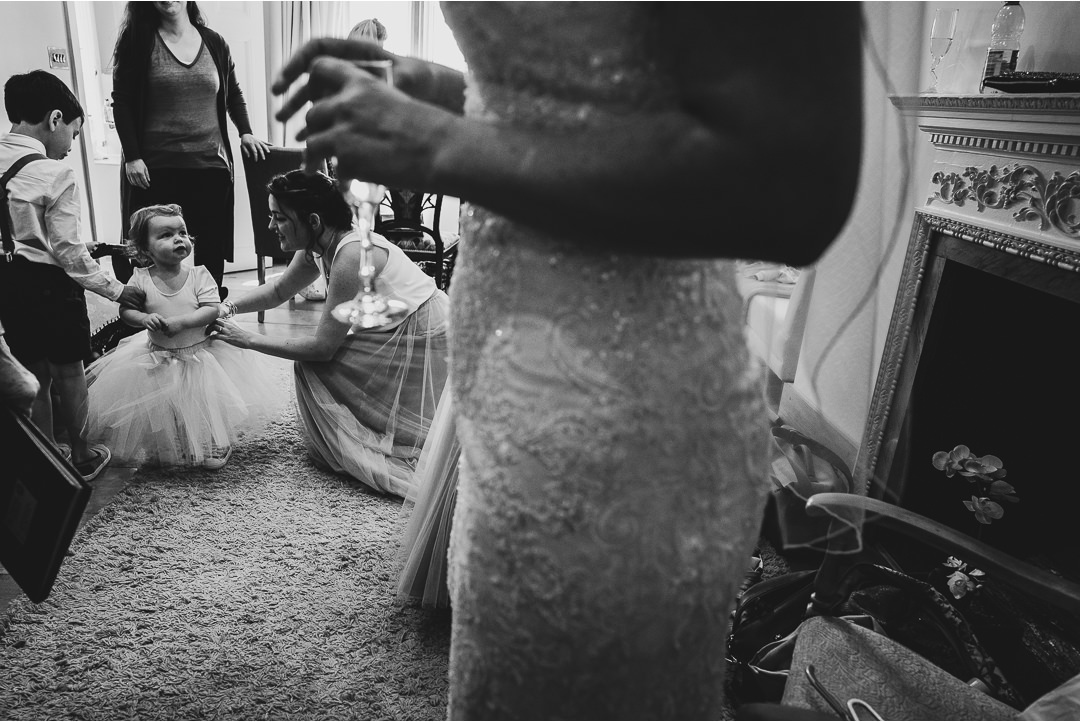 The flowergirl looking at her mother in her wedding dress