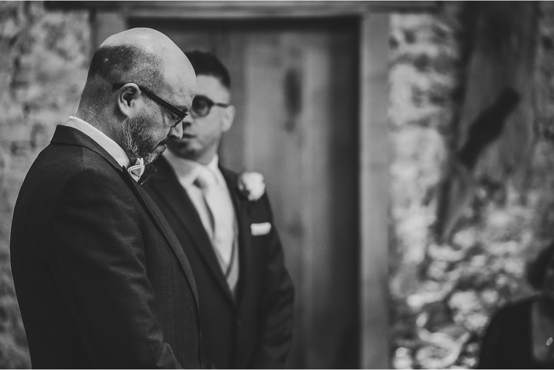 A Groom looking reflective before seeing his Bride