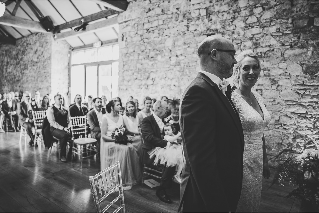 Bride and Groom during the wedding ceremony in Notley Abbey refectory