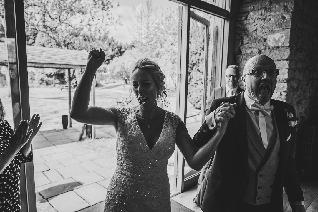 Bride and Groom walking into dinner at Notley Abbey