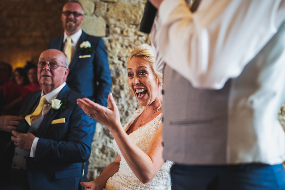 Bride's reaction during the speeches