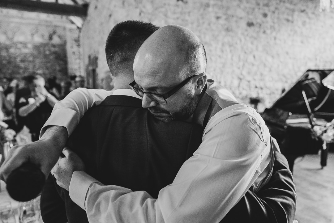The Groom and Best Man hug