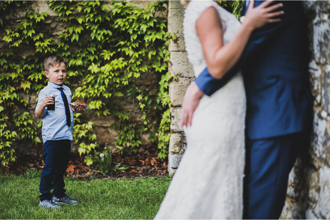 A young boy walking in on the couple shoot